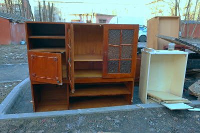 Old furniture on the street thrown into the garbage while cleaning the house.