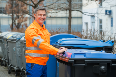 Happy Working Man Standing Near Dustbin On Street